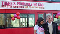 Dawkins posing in front of the God bus